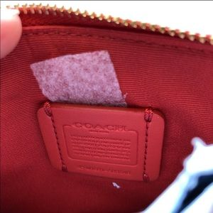 Coach Bags - NWOT Coach red & pink small wristlet